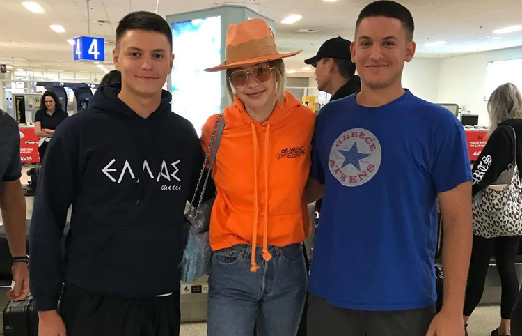 cd7ac5736813 She opted to travel in comfort by wearing a bright orange limited edition  hoodie from an exclusive collaboration between Chrome Hearts and Off-White  ...